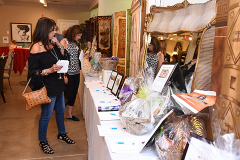 Taste of Italy guests perusing the Silent Auction items